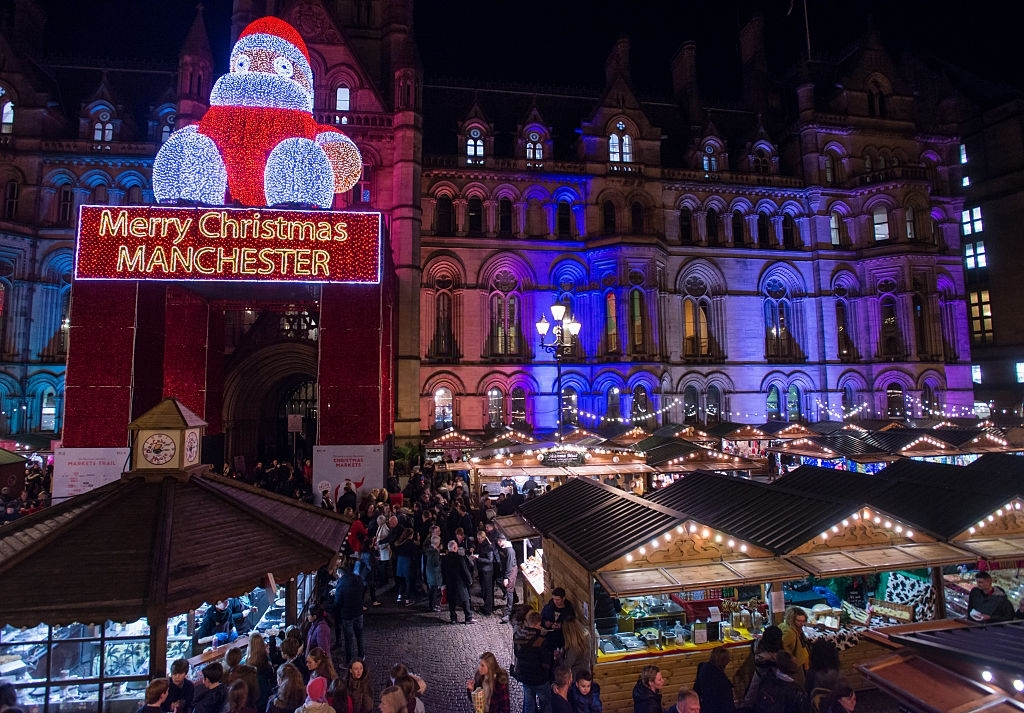 Shoppers Enjoy Manchesters Christmas Market With Food - Christmas Traditions in England