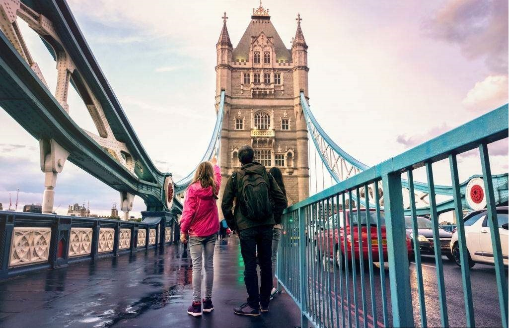 Family on Tower Bridge in London England - Best Time to Visit England - Planet Travel Advisor